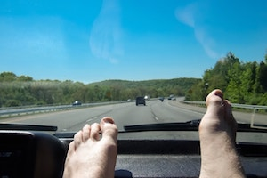 Feet on dashboard